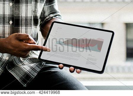 Black man display a digital tablet mockup