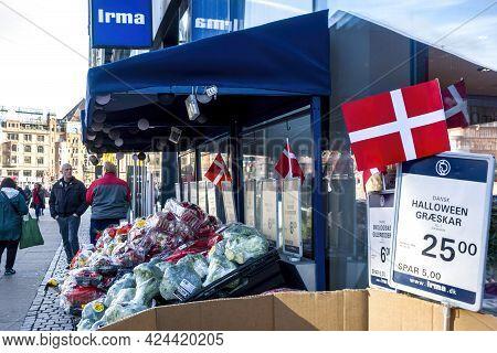 Copenhagen, Denmark - Oct 21, 2018: Signboard Of The Irma Convenience Store And Pedestrians Along Ve