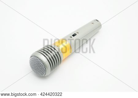 Microphone For Vocal Singing, Karaoke And Speaking On A White Background