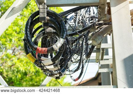 A Roll Of Fiber-optic Cables Hanging From A Pole. Optical Fiber Cable Of High Speed Internet Communi