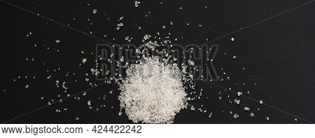 A Pinch Of Coarse Sea Salt Isolated On The Colorful Surface, Healthy Diet