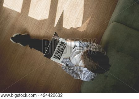 The Top Overhead View Of Male Person Laying On The Floor And Working On The Laptop During Covid-19 P
