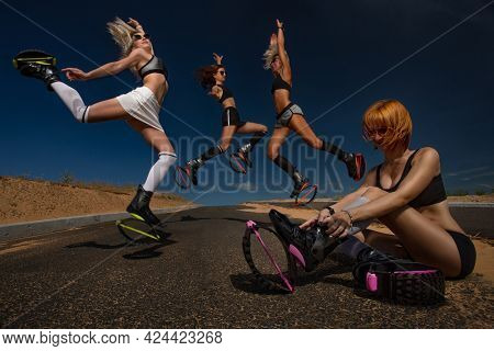 Group of girls doing exercises in kangoo jumping boots, one of them checking her jumping boot.