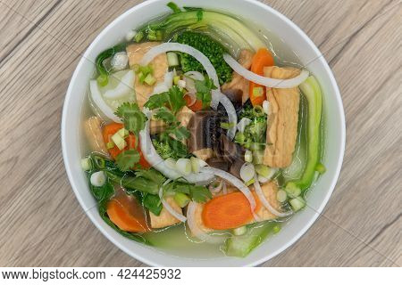 Overhead View Of Hearty Bowl Of Tofu Pho For The Vegetarian Appetite Served In A Hearty Bowl.
