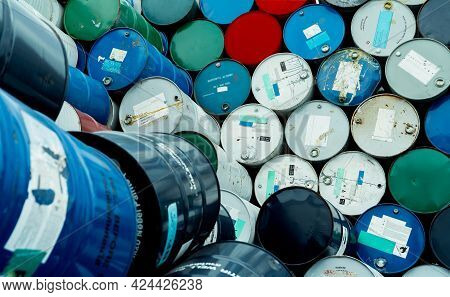 Old Chemical Barrels. Blue, Red, And Green Chemical Drum. Steel Tank. Hazard Chemical Barrel With Fl