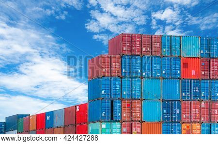 Red And Blue Logistic Container Against Blue Sky. Cargo And Shipping Business. Container Ship For Im