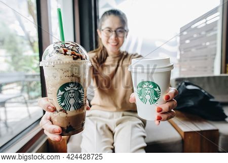 Chiang Mai, Thailand : May-15-2019 : Asian Woman Holding A Plastic Cup Of Triple Mocha Frappuccino W