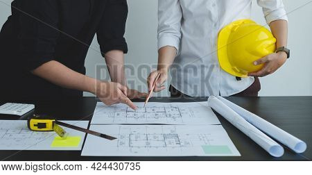 Team Of Engineers And Architects, Working Team, Meeting, Discussing Construction And Drawing Constru