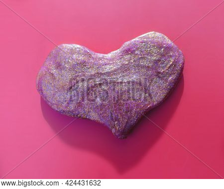 Textured  Slime In Heart Shape With Glitter Inside. Macro Of Kids Toy Slime.