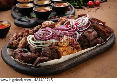 Mixed Delicious Grilled Meat With Onion. Bbq Collection In Caucasian Restrant.