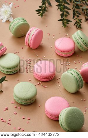 Macarons Surprisingly Tender Green And Pink Colors Neatly Laid Out On A Beige Background.