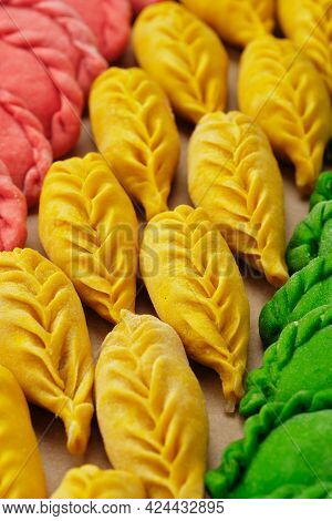 Dumplings Made By Hand In Different Green, Yellow, Red Colors.