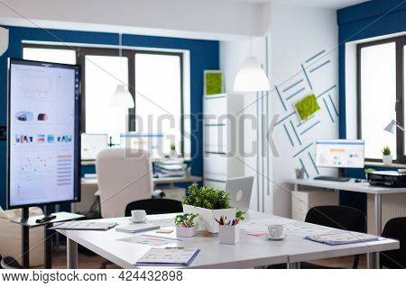 Empty Start Up Business Office, Cozy Light Company Room With Conference Table Ready For Brainstormin
