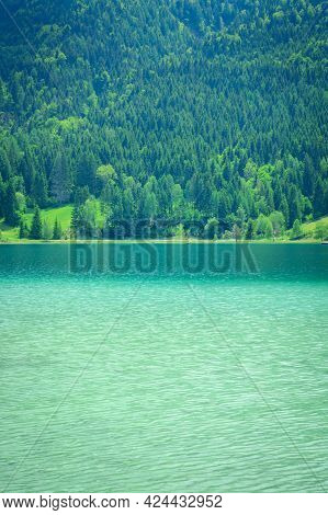 View Of The Weissensee Lake In Carinthia And Green Trees