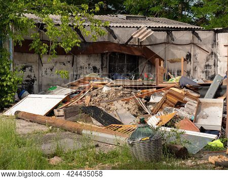 Parma, Italy - June 2021: Outdoor Dumping Of Various Materials, Old Furniture, Sofas And More.