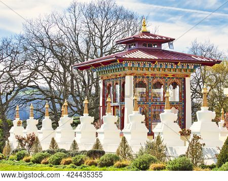 La Boulaye, France - April Circa, 2018. Several Small White Stupas With Traditional Eyes Of Buddha P