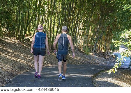 Mackay, Queensland, Australia - June 2021: A Man And Woman Getting Their Exercise Walking In The Bot