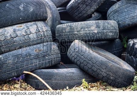 A Bunch Of Old Tires From Used Cars. Environmental Pollution. Dump Tires