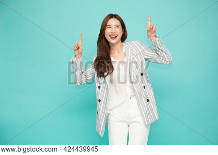 Portrait Of Southeast Asian Business Woman Smiling And Pointing Finger To Upper Empty Copy Space Iso