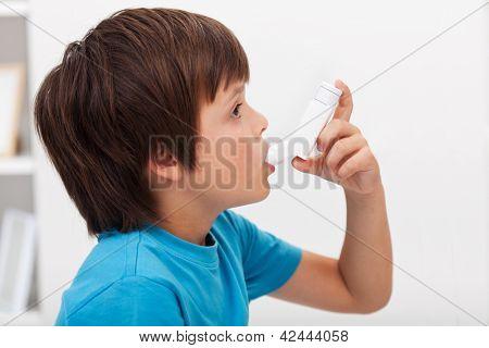 Boy using inhaler - respiratory system illness