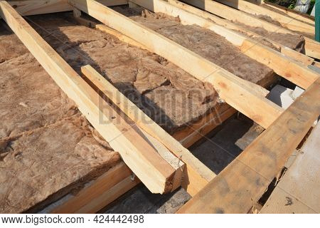 Mineral Wool Roofing, Attic Insulation, Heat Leak. A Close-up Of Mineral Wool Insulation Installed B