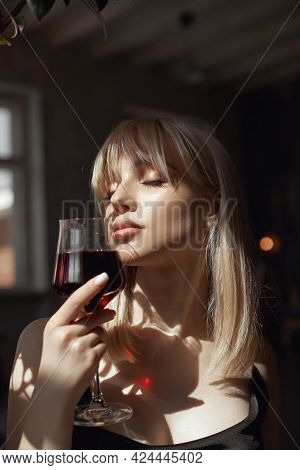 Retro Portrait Sexy Blonde Woman With Wine Glass In Black Dress, Vintage Interior Woman Posing At Wi