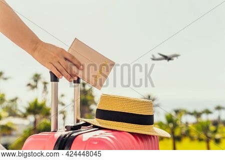 Woman With Pink Suitcase And Passport Standing On Passengers Ladder Of Airplane Opposite Sea Coastli