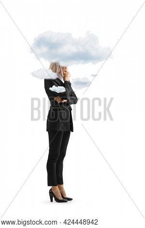 Full length shot of a young businesswoman with clouds around her head isolated on white background