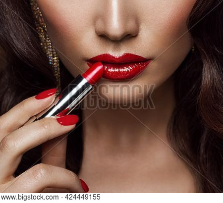 Beauty Model Applying Red Lipstick. Perfect Lips Make Up And Nail Polish Close Up. Glamour Face Make