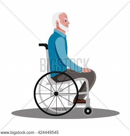 An Elderly Man Is Sitting In A Wheelchair. Smiling Grandfather With A Gray Beard Lives With A Disabi