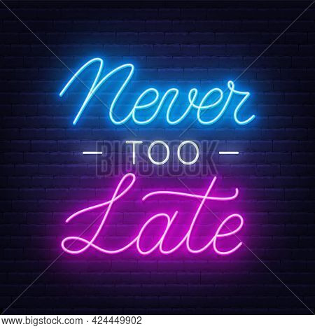 Never Too Late Neon Quote On A Brick Wall.