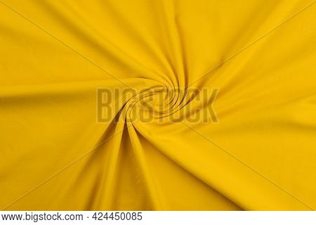 Background From Yellow Monochrome Cotton Fabric. Close Up Texture