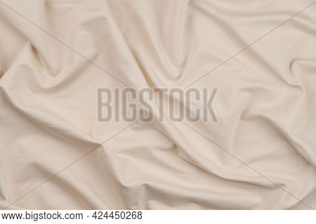 Background From Light Beige Monochrome Cotton Fabric. Close Up Texture