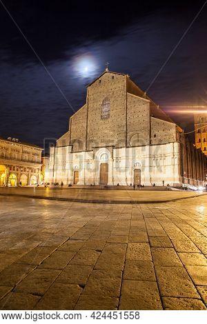 Basilica of San Petronio and Piazza Maggiore in Bologna at moonlit night, Italy. Cityscape