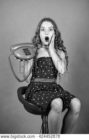 Surprised Kid Sit On Chair Dial Phone. Communication Concept. Retro Style. Shopping Online. Retro Gi