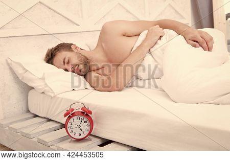 Sleeping Clock Round. Sleeping Man In Bed. Sexy Guy Sleep In Sleeping Room. Bed And Bedding. Bedroom