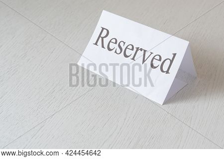 The Plate Or Paper Board With A Reserved Word Text In A Restaurant Inside