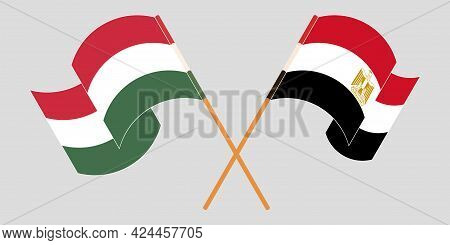 Crossed And Waving Flags Of Egypt And Hungary