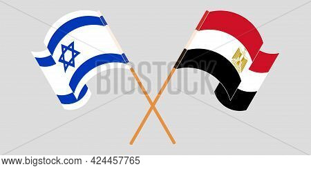 Crossed And Waving Flags Of Egypt And Israel
