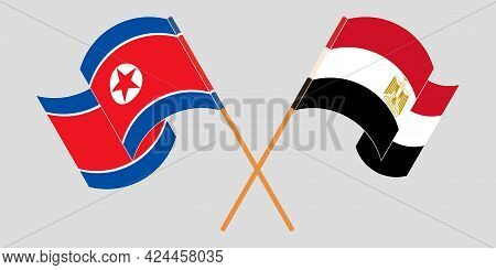 Crossed And Waving Flags Of Egypt And North Korea