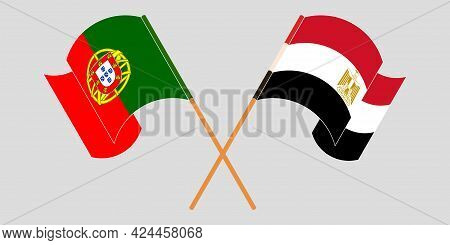 Crossed And Waving Flags Of Egypt And Portugal