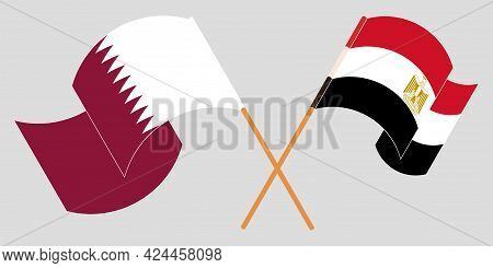 Crossed And Waving Flags Of Egypt And Qatar