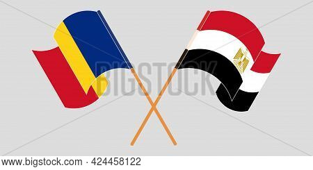 Crossed And Waving Flags Of Egypt And Romania