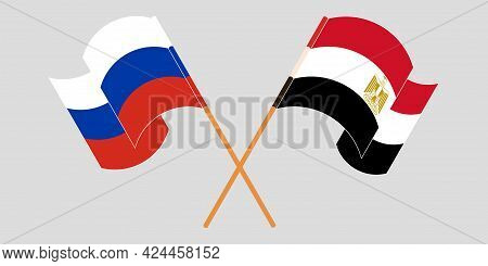 Crossed And Waving Flags Of Egypt And Russia