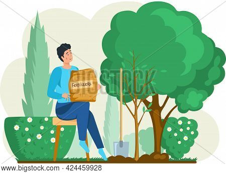 Gardening Concept. Spring Planting. Man Gardener Takes Care Of Seedlings In Garden Uses Fertilizers,