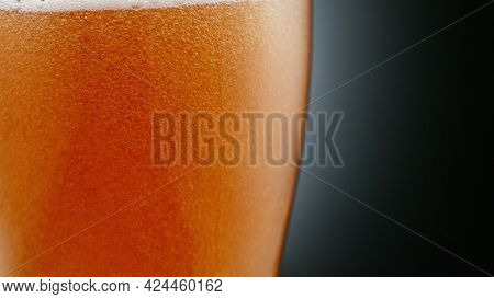 Close-up of beer pint with free space for text. Abstract beverages background.