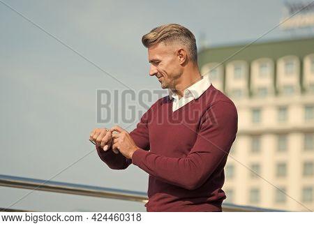 Man Check Watch Urban Background. Handsome Man Wear Wrist Watch. Using Smart Watch. Modern Lifestyle
