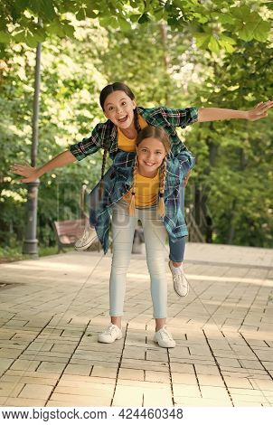 Free Your Energy. Energetic Children Piggybacking Outdoors. Playing Games In Park. Childhood Friends
