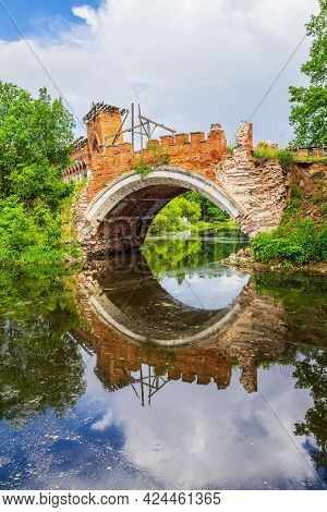 Old Stone Bridge Arch With Reflection In Water, Ruined Historic Architecture