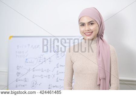Muslim Woman Lecturer Using Laptop For Lecturing Online Via Internet. E-learning And Telecommunicati